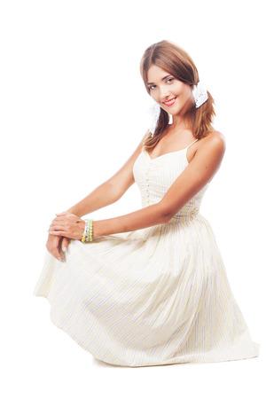 sundress: Portrait of a lovely woman in sundress against white background