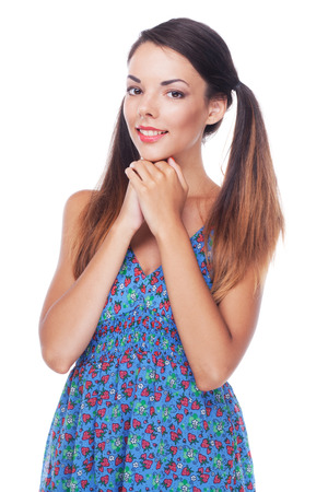 wondered: Young beautiful woman in blue sundress against white background
