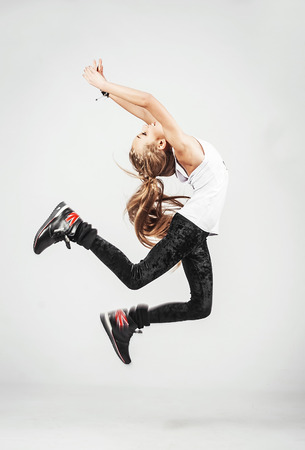 teen dance: Lovely teenage dancer is jumping high Stock Photo