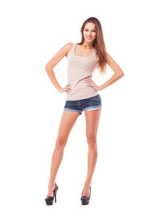 sexy shorts: Young beautiful woman against white background