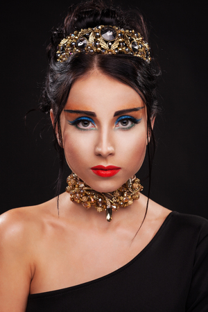 queen of diamonds: Gorgeous woman in luxury jewelry against black background