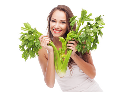 celery: Lovely woman with celery on white background