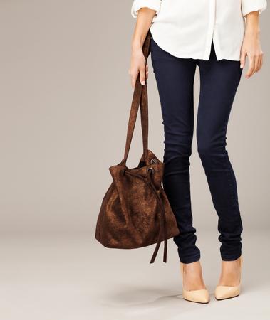 no heels: Elegant woman with a fashion bag