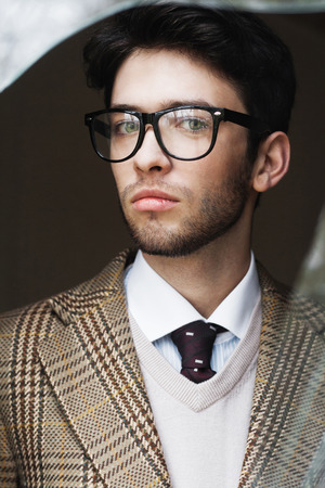 british man: Outdoor portrait of a handsome man wearing glasses. British style