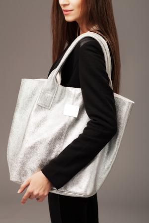 big women: Elegant woman with a silver fashion bag