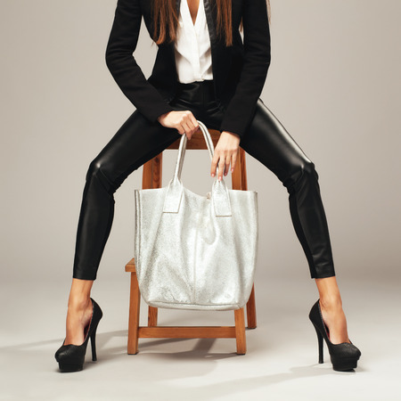 no heels: Elegant woman with a silver fashion bag