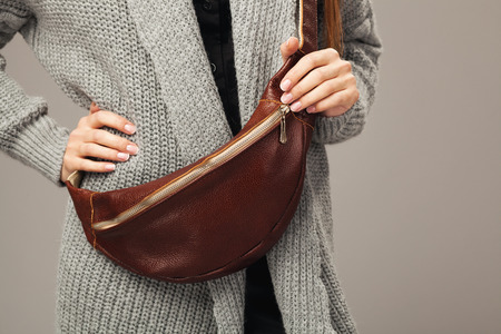 Elegant woman with a leather fanny pack. Closeup picture Stock Photo