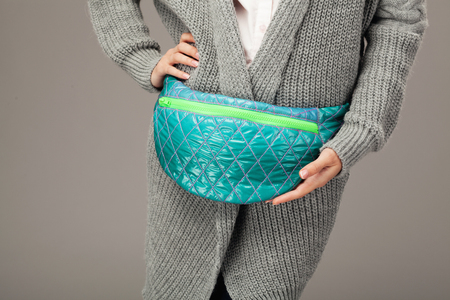 Elegant woman with a fanny pack. Closeup picture photo