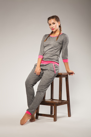 tracksuit: Beautiful sporty woman in gray sweatsuit  Stock Photo