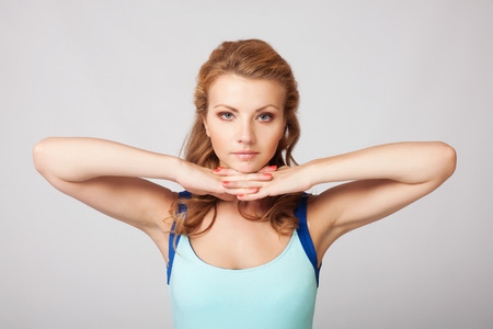 figure out: Beautiful sporty woman doing exercise Stock Photo