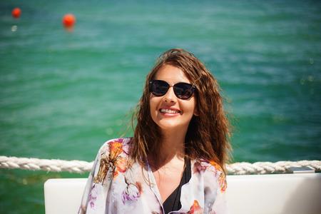 Beautiful woman enjoing with a fresh sea breeze Stock Photo