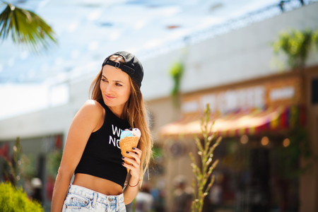 Pretty girl with ice cream on summer vacation photo