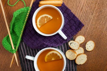 Black Lemon Tea on Knitted Napkins  Фото со стока