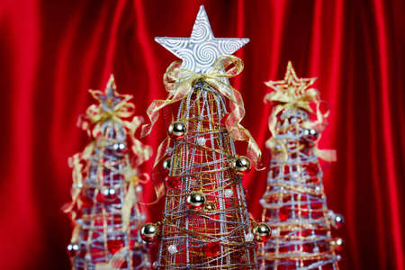 Wire Christmas Trees with Decorations on Red Drapery Background Stok Fotoğraf - 16822944