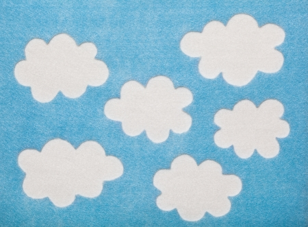 White Felted Clouds on Blue Background