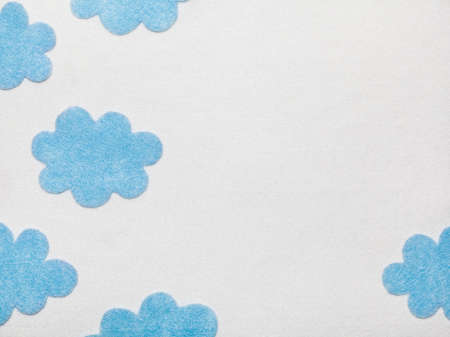 Blue Felted Clouds on White Background