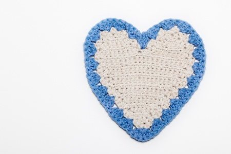 White Blue Crochet Knitted Heart on White Background Reklamní fotografie