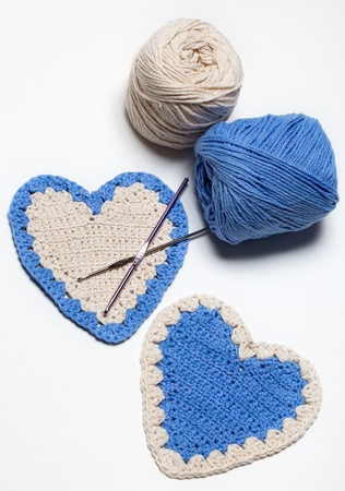 White Blue Crochet Knitted Hearts on White Background