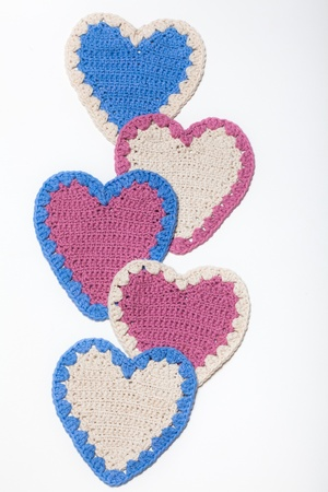 White Pink Blue Crochet Knitted Hearts on White Background Reklamní fotografie
