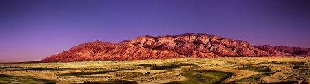 Sandia Mountain range in Albuquerque, NM at sunset. Panorama Stock Photo