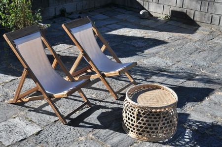 seater: two chairs and basket under the sunshine