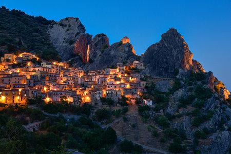 Beautiful small village Castelmezzano in dolomiti lucane on mountains at the blue hour