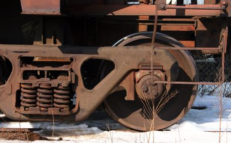 Old rusted freight train wheel sitting on the tracks Stock Photo