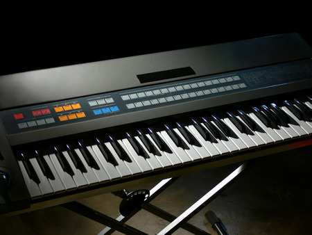 Electronic synthesizer keyboard in a dark room photo
