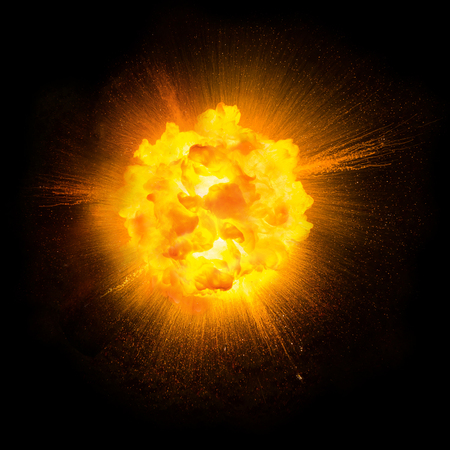 Realistic fiery explosion with sparks over a black background