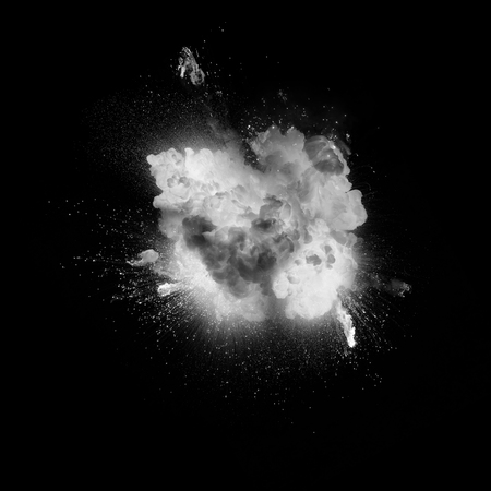 Fireball explosion with sparks over black background