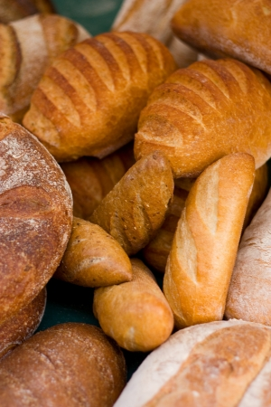 french bread rolls: a selection of bread at a market. Stock Photo