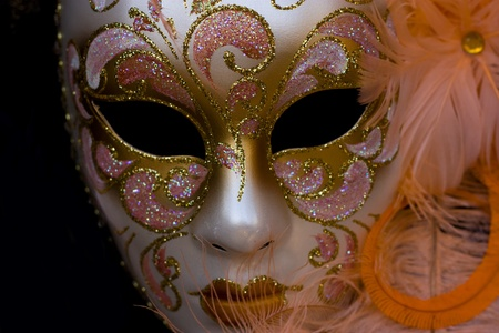 a ornate carnival mask isolated on a black background.  photo