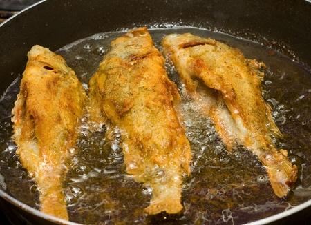 pan fried: fish frying. Stock Photo
