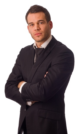 young businessman osing with crossed arms. photo