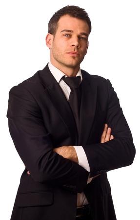 traje: negocios con los brazos cruzados.