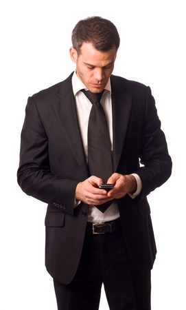 sms text: business man holding a mobile phone.