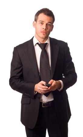 a young businessman holding a phone.  photo