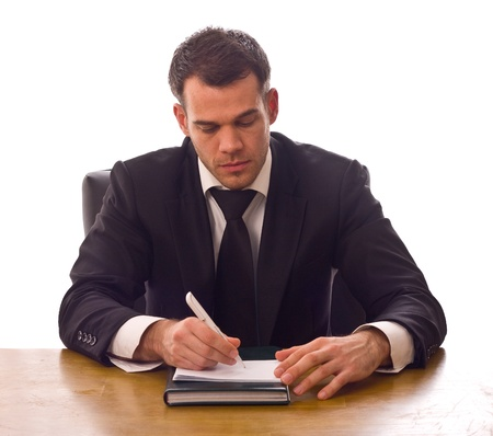 책상 쓰기에 젊은 비즈니스 사람.