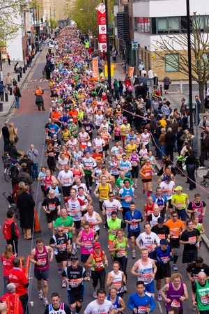 LONDON - APRIL 22: Unidentified people run the London marathon on April 22, 2012 in London, England, UK. The marathon is an annual event. Stock Photo - 13315490