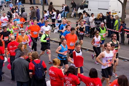 LONDON - APRIL 22: Unidentified people run the London marathon on April 22, 2012 in London, England, UK. The marathon is an annual event. Stock Photo - 13315463