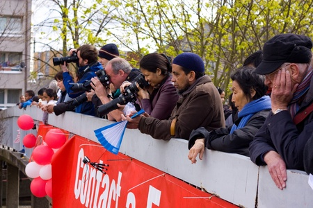 LONDON - APRIL 22: Unidentified photographers shoot the marathon from a bridge on April 22, 2012 in London, England, UK. The marathon is an annual event.