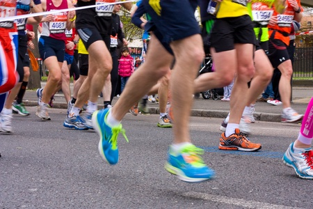 LONDON - APRIL 22: Unidentified people run the London marathon on April 22, 2012 in London, England, UK. The marathon is an annual event. Stock Photo - 13316026
