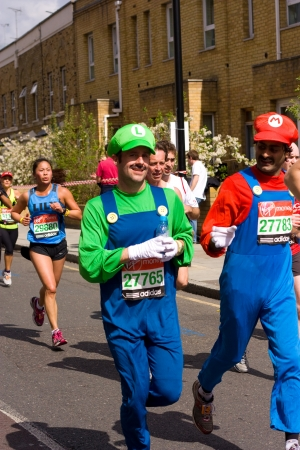 LONDON - APRIL 22: Nash Pradhan and Dan McCormack run the London marathon  dressed as mario and luigi on April 22, 2012 in London, England, UK. The marathon is an annual event.