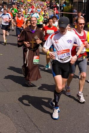 LONDON - APRIL 22: Unidentified man runs the London marathon on April 22, 2012 in London, England, UK. The marathon is an annual event. Stock Photo - 13537426