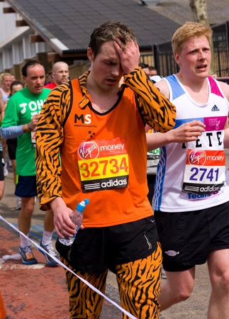 LONDON - APRIL 22: Unidentified man run the London marathon on April 22, 2012 in London, England, UK. The marathon is an annual event. Stock Photo - 13537120