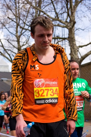 LONDON - APRIL 22: Unidentified man run the London marathon on April 22, 2012 in London, England, UK. The marathon is an annual event.