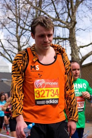 LONDON - APRIL 22: Unidentified man run the London marathon on April 22, 2012 in London, England, UK. The marathon is an annual event. Stock Photo - 13537435