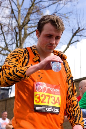 LONDON - APRIL 22: Unidentified man runs the London marathon on April 22, 2012 in London, England, UK. The marathon is an annual event. Stock Photo - 13537434