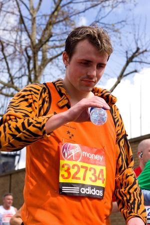 LONDON - APRIL 22: Unidentified man runs the London marathon on April 22, 2012 in London, England, UK. The marathon is an annual event. Stock Photo - 13537434