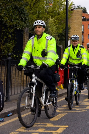 LONDON - APRIL 22: Police officers on bicycles during the London marathon on April 22, 2012 in London, England, UK. The marathon is an annual event Stock Photo - 13537421